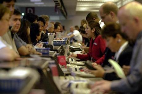 American Airlines employees try to find flights for passengers at Logan Airport in Boston, Massachusetts September 15, 2001 after the airport re-opened earlier in the day. Logan Airport has been closed since an American and a United flight from Boston were hijacked and crashed into the World Trade Center in New York City September 11. REUTERS/Brian Snyder 10logan airlinegallery